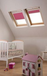 Rooflite Blinds in Pink in a loft girl's bedroom