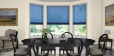Three Oxford Blue 0065 Venetian Blinds 25 mm set in a dining room