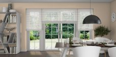 Three Timeless Cream 0179 Venetian Blinds set in a kitchen