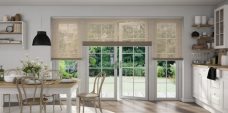 Three Stardust Gold 0714 Venetian Blinds set in a kitchen