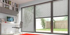 Three Brushed Silver Venetian Blinds Slat 25 mm set in an office