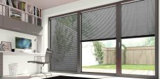 Three Hammered Black 0985 Venetian Blinds 25 mm set in an office