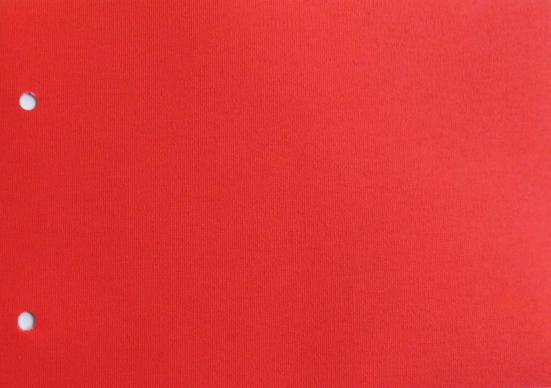 Carnival Red Blocout - A bright red fabric with a white backing