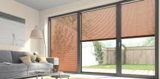 Three Wood Effect Rowan 9943 Venetian Blinds set in a lounge