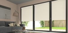 Three Atlantex Cream Solar Reflective Roller blinds set in a lounge