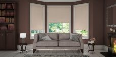Three Atlantex Dark Beige Solar Reflective Roller blinds set in a lounge