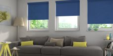 Three Atlantex Dark Blue Solar Reflective Roller blinds set in a lounge