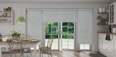 Three Atlantex Silver Solar Reflective Roller blinds set in kitchen