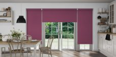 Three Atlantex Aubergine Solar Reflective Roller blinds set in kitchen with white cupboards and black accessories