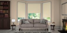 Three Atlantex Beige Roller blinds set in a lounge with beige walls
