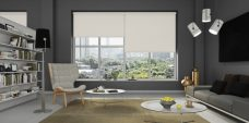Three Atlantex Stone Roller blinds set in an office