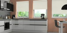 Three Atlantex Vanilla Solar Reflective Roller blinds set in kitchen