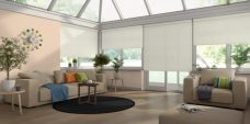 Four Atlantex Vanilla Roller blinds set in a conservatory with neutral colour scheme