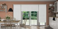 Three Atlantex White Roller blinds set in country kitchen with white cupboards