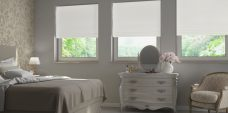 Three Baltimore White Roman Blinds in a bedroom setting