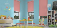 Three Banlight Coral Roller Blinds set in a child's room