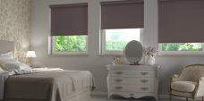 Three Banlight Espresso Roller Blinds set in a bedroom