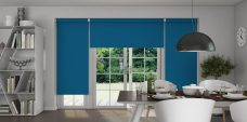 Three Banlight Atlantic Blue Roller Blinds set in dining room