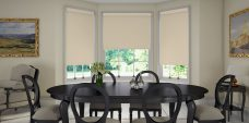 Three Banlight Beige Roller Blinds set in a dining room