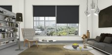 Three Banlight Black Roller Blinds set in a living room