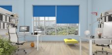 Three Banlight Blue Roller Blinds set in an office