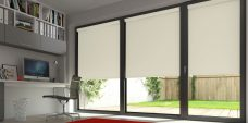Three Banlight Calico Roller Blinds set in a study