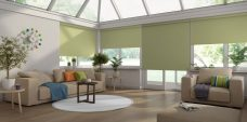Four Banlight Green Roller Blinds set in a conservatory