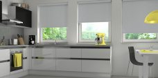 Three Banlight Grey Roller Blinds set in a kitchen