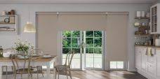 Three Banlight Henna Roller Blinds set in a country kitchen