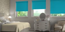Three Banlight Kingfisher Roller Blinds set in a bedroom