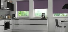 Three Banlight Mulberry Roller Blinds set in a kitchen