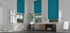 Three Banlight Ocean Roller Blinds set in a bathroom