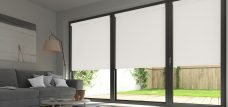 Three Banlight Optic White Roller Blinds set in a lounge