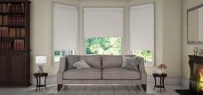 Three Banlight Pearl Roller Blinds set in a lounge