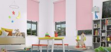 Three Banlight Pink Roller Blinds set in a child's room