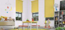 Three Banlight Primrose Roller Blinds set in a child's room