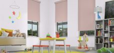 Three Banlight Rose Roller Blinds set in a child's room