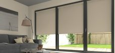Three Banlight Sand Roller Blinds set in a living room