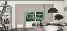 Three Banlight Stone Grey Roller Blinds set in a dining room