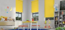 Three Banlight Sunflower Roller Blinds set in a child's room