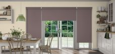 Three Banlight Taupe Roller Blinds set in a kitchen