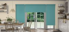 Three Banlight Turquoise Roller Blinds set in a kitchen