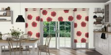 Three Camilla Rosa Roller Blinds in a kitchen setting