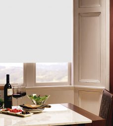 Carnival China White Roller Blind in dining room setting