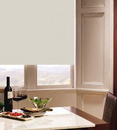 Carnival Ivory Roller Blind in dining room setting
