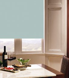 Carnival Lily Roller Blind in dining room setting