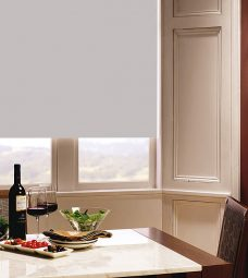 Carnival Taupe Roller Blind in dining room setting