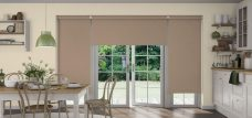 Three Chancery Beige Roller blinds in a kitchen