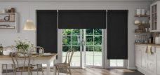Three Chancery Black Roller blinds in a kitchen