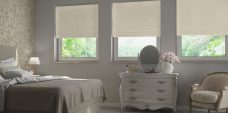 Three Chardonnay Ivory Roman Blinds set in a bedroom